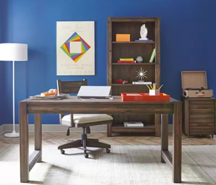 macys home office desk with blue wall